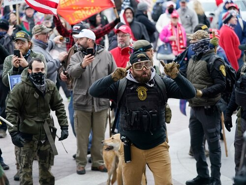 Rioters, including several veterans and members of hate groups, stormed the U.S. Capitol building on Jan. 6. (Manuel Balce Ceneta/AP)