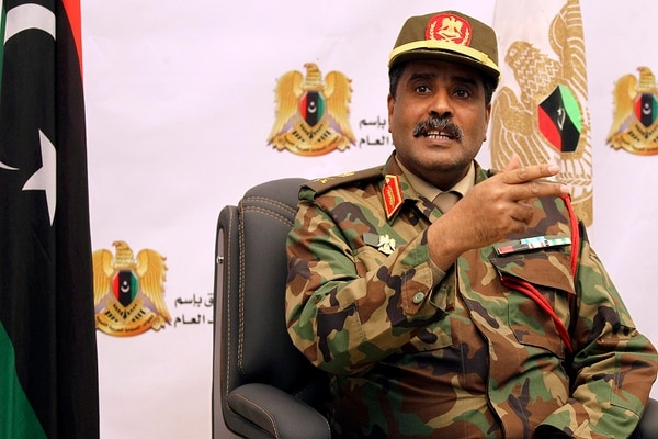Brig. Ahmed al-Mesmari, spokesman of the self-proclaimed Libyan National Army loyal to Khalifa Hifter, addresses the press in his office in Benghazi on April 4, after declaring preparations were almost complete
