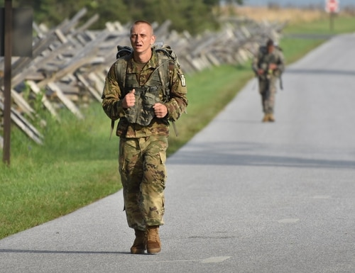 New York Army National Guard Sgt. Ilya Titov competes in a 12-mile ruck march around Gettysburg Battlefield Park. A new performance bar aims to add calcium and vitamin D to soldier diets to help prevent bone injuries. (Spc. Andrew Valenza/Army)