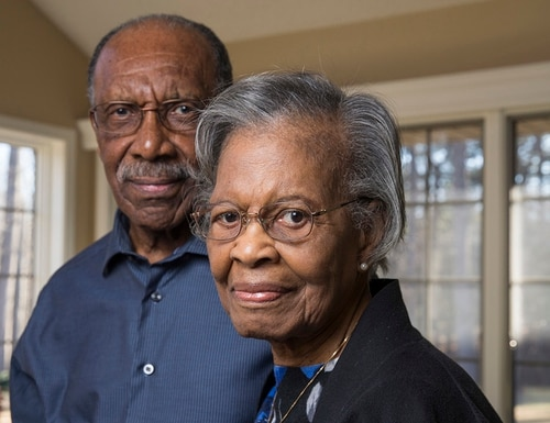 In a Jan. 19, 2018 photo, Gladys West and her husband Ira West stand in their home in King George, Va. West was part of the team that developed the Global Positioning System in the 1950s and 1960s. (Mike Morones/The Free Lance-Star via AP)