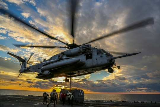 A CH-53E Super Stallion helicopter picks up an AV-8B Harrier engine to during a Helicopter Support Team mission as part of Combined Composite Training Unit Exercise, Dec. 1, 2017, in the Atlantic Ocean. (Cpl. Jon Sosner/Marine Corps)
