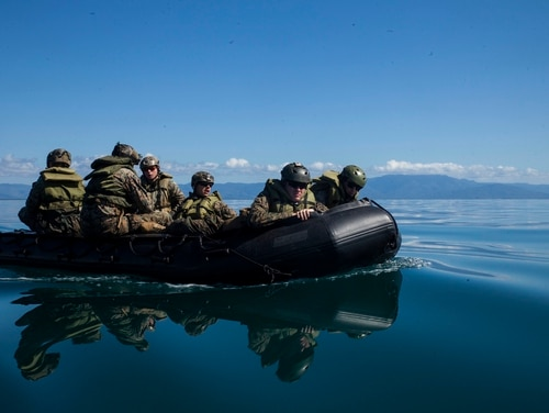 Marines with the 31st Marine Expeditionary Unit navigate inside the Australian Defence Force's Cowley Beach Training Area during an amphibious raid rehearsal July 8. (Lance Cpl. Jonah Baase/Marine Corps)