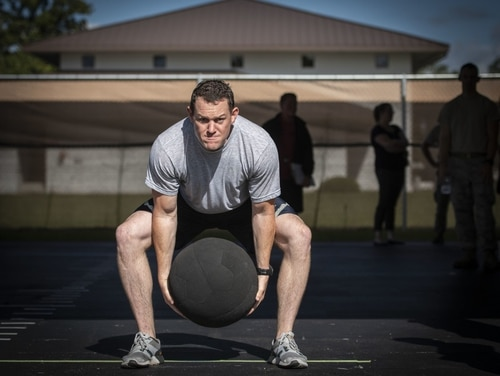 Tech. Sgt. Cole Carroll-Grandegenett, with the 52nd Civil Engineer Squadron at Spangdahlem Air Base, Germany, performs an overhead medicine ball throw during the beta test of the explosive ordnance disposal Tier 2 fitness test prototype in September 2018 at Eglin Air Force Base, Fla. The Tier 2 tests and standards were developed from EOD-specific physical requirements and the tasks they perform on operational missions. (Ilka Cole/Air Force)