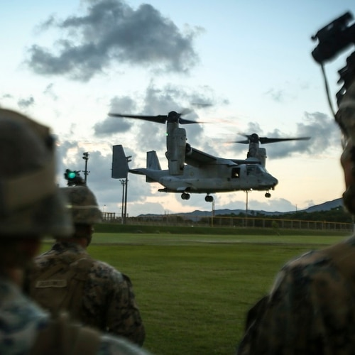 Marines assigned to Bravo Company, 1st Battalion, 3rd Marine Regiment, observe an MV-22 Osprey land aboard Camp Hansen, Okinawa, Japan, Nov. 2, 2017. (Sgt. Aaron S. Patterson/Marine Corps)