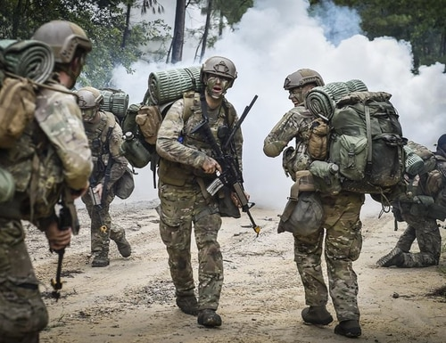 Combat Control School students assigned to the 352nd Battlefield Airman Training Squadron are ambushed at their drop-off point during a tactics field training exercise at Camp Mackall, N.C., in August 2016. (Senior Airman Ryan Conroy/Air Force)