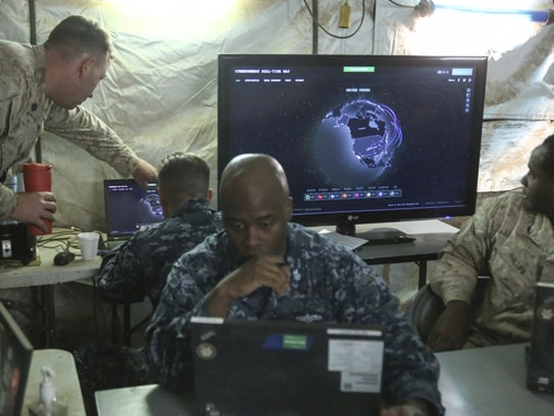 Marines with I Marine Expeditionary Force and sailors with 553 Cyber Protection Team, monitor network activity during I MEF Large Scale Exercise 2016 (LSE-16) at Marine Corps Air Station Miramar, California. (Cpl. Garrett White/ Marine Corps)