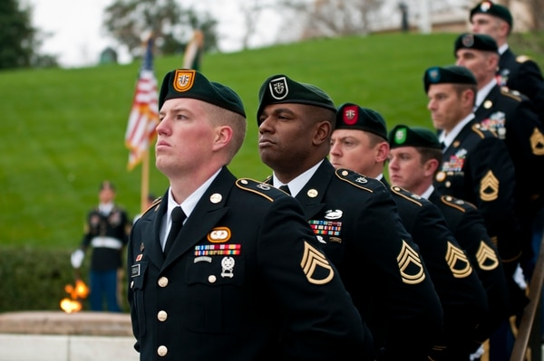 Green Beret soldiers from each of the Army's seven Special Forces Groups stand silent watch during a wreath-laying ceremony at the grave of President John F. Kennedy, The ceremony marks a time-honored tradition to honor Kennedy for his support and advocacy of the elite soldiers. (Sgt. 1st Class Jeremy D. Crisp/Army)