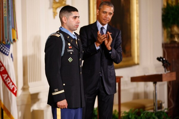 President Obama presents retired US Army Capt. Florent
