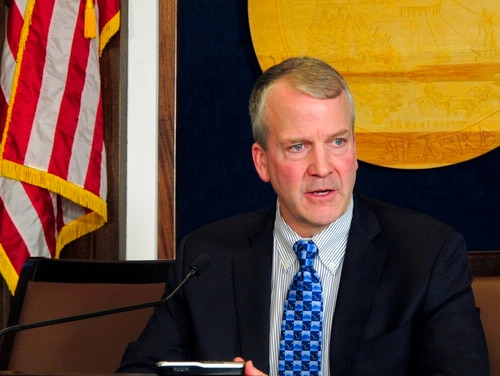 U.S. Sen. Dan Sullivan speaks to reporters on Feb. 21 after giving his annual address to a joint session of the Alaska Legislature in Juneau. (Becky Bohrer/AP)
