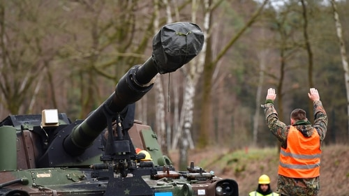 Members of the German Army (Bundeswehr) load a U.S. howitzer from a rail car onto a heavy-goods transporter at the Bergen Hohne training facility as part of preparations for the U.S.-led Defender 2020 international military exercises on Feb. 12, 2020, near Bergen, Germany. (Photo by Alexander Koerner/Getty Images)