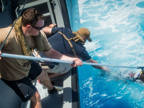 The Navy stood up its first underwater drone squadron last year, part of its effort to ramp up such technology. Sailors are shown here last year fishing such a vehicle out of the Pacific Ocean. (Navy)