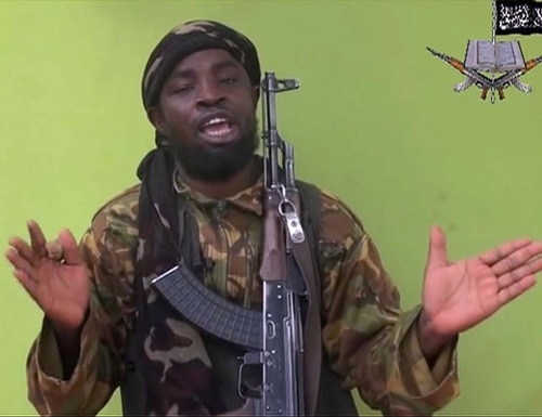 FILE -This Monday, May 12, 2014, file photo taken from video by Nigeria's Boko Haram terrorist network, shows their leader Abubakar Shekau speaking to the camera. Shekau has allegedly made a formal allegiance to the Islamic State on Saturday, March 7, 2015, in an Arabic audio message with English subtitles and was posted on Twitter, according to the SITE Intelligence monitoring service. (AP Photo, File)