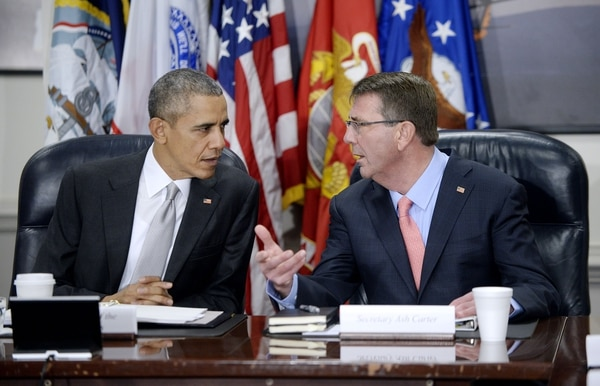 ARLINGTON, VA - DECEMBER 14: U.S. President Barack Obama (L) and U.S. Defense Secretary Ash Carter talk during a national security council meeting on the counter-ISIL campaign at the Pentagon December 14, 2015 in Arlington, Virginia. Obama was expected to receive an update from his national security team and talk about ways to fight ISIL. (Photo by Olivier Douliery-Pool/Getty Images)