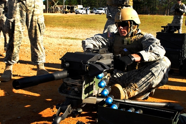 Staff Sgt. Scott Goostree, an assistant team leader for 14th Chemical Reconnaissance Detachment, 3rd Special Forces Group, charges a MK19 grenade launcher with a belt of 40 mm training rounds during a heavy weapons range meant to familiarize support personnel with the larger weapons in use downrange Nov. 20 at Fort Bragg, N.C.