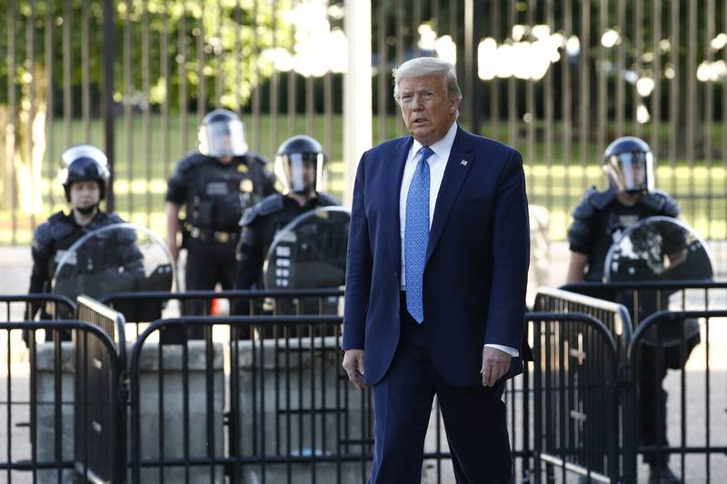 President Donald Trump walks in Lafayette Park to visit outside St. John's Church across from the White House Monday, June 1, 2020, in Washington.