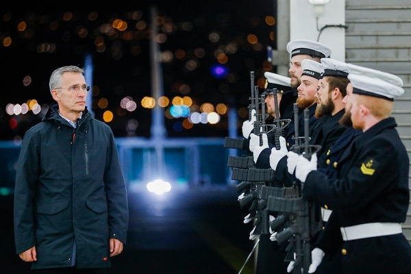 NATO Secretary General Jens Stoltenberg arrives at the Danish support ship HDMS Esbern Snare during his visit to the NATO exercise Trident Juncture 2018, in Trondheim, Norway, Monday, Oct. 29. 2018. (Gorm Kallestad/NTB scanpix via AP)