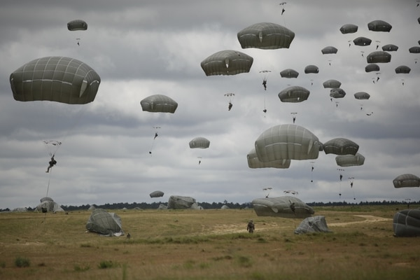Soldiers from the XVIII Airborne Corps perform a static line jump at Fort Bragg, North Carolina. The corps headquarters is headed to Iraq this summer. (Sgt. Tierney P. Curry/Army)