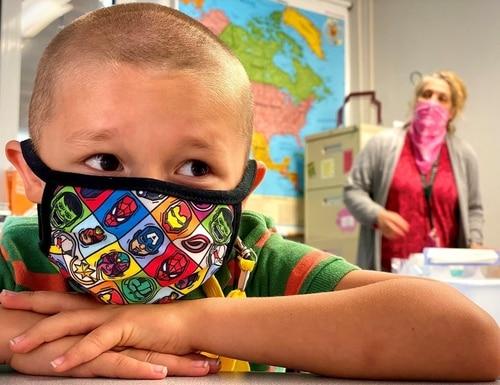 Sporting an Avengers coronavirus mask, Liam Hall waits for his second grade class to begin at Patch Elementary School, at Panzer Kaserne in Böblingen, Germany. (Rick Scavetta, U.S. Army Garrison Stuttgart)