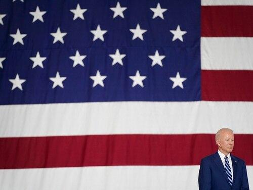 President Joe Biden listens as first lady Jill Biden speaks at Joint Base Langley-Eustis in Hampton, Va., May 28, 2021. (Patrick Semansky/AP)