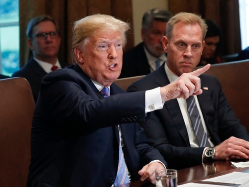 President Donald Trump gestures while speaking during his meeting with members of his cabinet in Cabinet Room of the White House in Washington, Wednesday, July 18, 2018. Looking on is Deputy Secretary of Defense Patrick Shanahan. (Pablo Martinez Monsivais/AP)