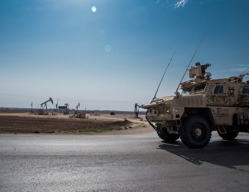 In this Oct. 28, 2019 photo, U.S. forces patrol Syrian oil fields. (Baderkhan Ahmad/AP)