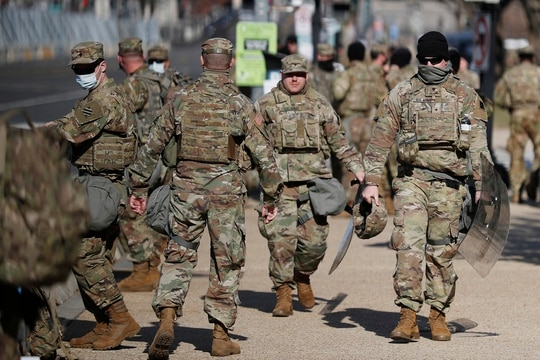 National Guard troops continue to be deployed around the Capitol one day after the inauguration of President Joe Biden, Thursday, Jan. 21, 2021, in Washington. (Rebecca Blackwell/AP)