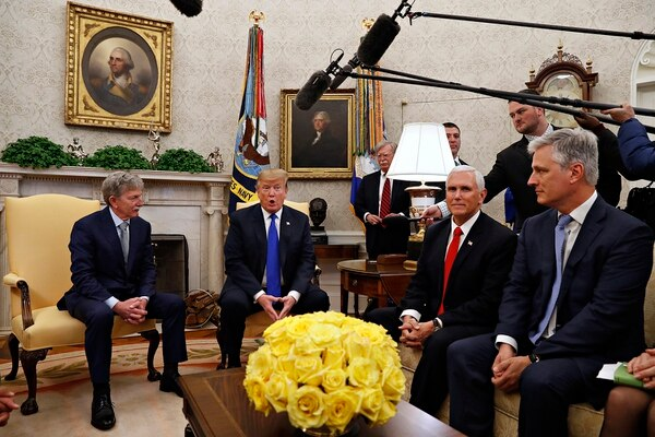 In this March 6, 2019, file photo, former U.S. hostage in Yemen, Danny Burch, left, listens as President Donald Trump speaks, Wednesday, March 6, 2019, in the Oval Office of the White House in Washington, next to Vice President Mike Pence, and Special Presidential Envoy for Hostage Affairs Robert O'Brien. At back, to the right of Trump, is then-national security adviser John Bolton. (Jacquelyn Martin/AP)