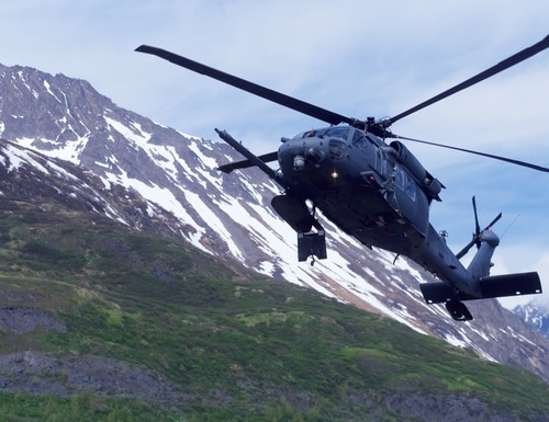 An HH-60G Pave Hawk with the 210th Rescue Squadron conducts hoist training in June 2018 at Eklutna Glacier in Alaska. (David Bedard/Air National Guard)