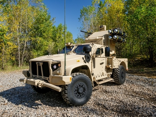 A version of the Joint Light Tactical Vehicle is shown with an Avenger air defense launcher on the back. (Courtesy of Oshkosh)
