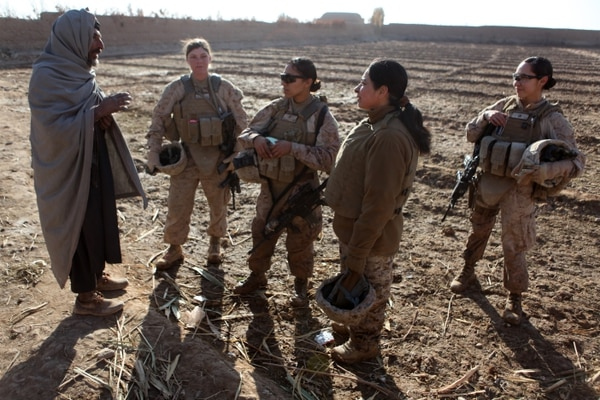 U.S. Marines assigned to a female engagement team (FET) speak with a local Afghan man in his compound during a patrol in Marjah, Helmand province, Afghanistan, Dec. 30, 2010. The FET worked with infantry Marines by engaging women and children in support of the International Security Assistance Force. (U.S. Marine Corps photo by Cpl. Marionne T. Mangrum/Released)