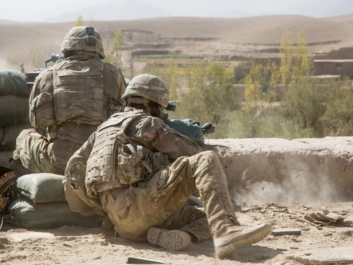 Attached infantry soldiers on patrol with Afghan Special Security Forces return fire during a Taliban attack on their position in Logar province, Oct. 12, 2018. (Defense Department)