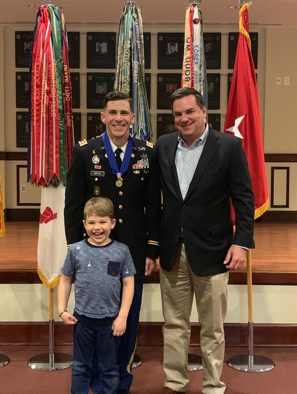Army Capt. Jacob Riffe, his 6-year-old son and Rep. Richard Hudson, R-N.C., pose during the award ceremony where Riffe was presented with the Soldier's Medal of heroism on March 22 at Fort Bragg, N.C. (1st Lt. Matt Ostergaard/Army)