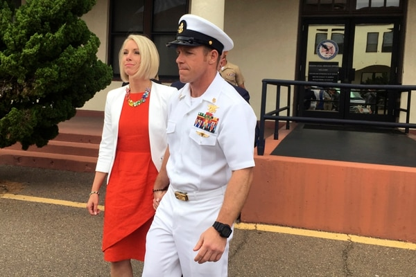 """Special Warfare Operator Chief Edward """"Eddie"""" Gallagher leaves a military courtroom on Naval Base San Diego with his wife, Andrea, on May 30, 2019. (Julie Watson/AP)"""
