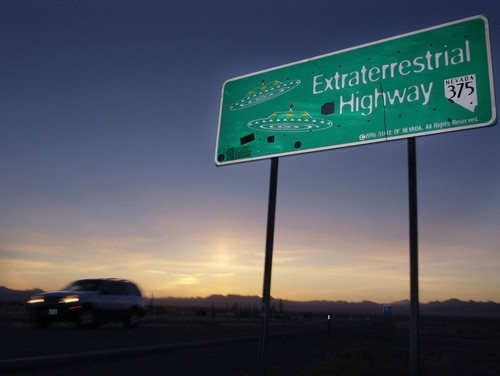 """FILE - In this April 10, 2002, file photo, a car moves along the Extraterrestrial Highway near Rachel, Nev, the closest town to Area 51. The U.S. Air Force is giving an ultimatum to owners of the remote Nevada property: Take a $5.2 million """"last best offer"""" by Thursday,, Sept. 10, 2015, for their property now surrounded by a vast bombing range including the super-secret Area 51, or the government will seize it. (AP Photo/Laura Rauch, File)"""