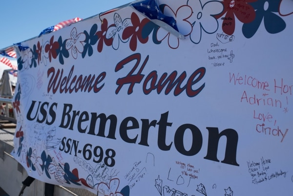 Friends and family welcomed Bremerton sailors home April 6. (MC1 Daniel Hinton/Navy)
