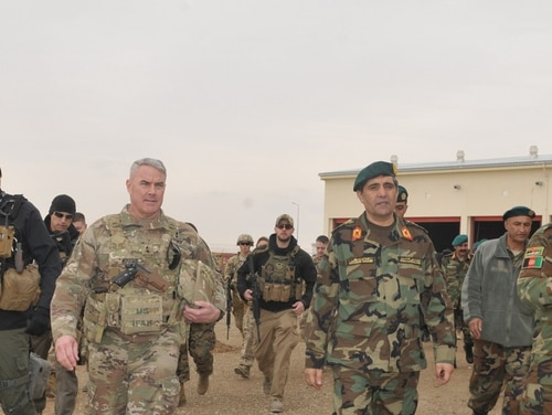 Maj. Gen. Richard Kaiser, then-commanding general of Combined Security Transition Command-Afghanistan, tours logistics warehouses in Helmand province in February 2017 to assess logistical challenges and evaluate next steps to build capacity and sustainment. (Lt. Egdanis Torres Sierra/Navy)