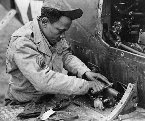 27825 AC - THOSE BELL P-39 AIRCOBRAS - being used by a Negro fighter group operating witht he Mediterranean Aillied Air Forces must be kept in good condition mechanically. That's where SSgt James McGee, of Marianna, Ark., comes in for his offering. He has served in England, Africa, Sicily, and now in Italy. (ca Mar 1944) Fold3