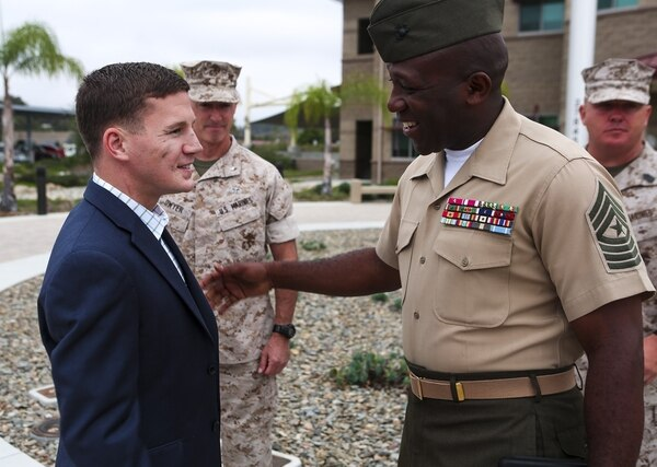Commandant of the Marine Corps Gen. Joseph F. Dunford Jr. announced the selection of Sgt. Maj. Ronald L. Green as the next Sergeant Major of the Marine Corps, Jan. 20, 2015. In this 2014 photo, Sgt. Maj. Green, the I Marine Expeditionary Force's sergeant major, greets Medal of Honor recipient Cpl. William