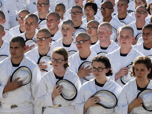 Changes to the Navy's authorized hairstyles for women while in uniform will not apply to midshipmen at the U.S. Naval Academy. Pictured: Plebes during Induction Day on June 28, 2018, at the Naval Academy in Annapolis, Md.