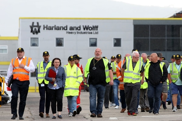 Harland and Wolff shipyard workers emerge with union reps after an Aug. 5, 2019, meeting at the shipyard, vowing to continue their picket at the gates until their jobs are secure. (Paul Faith/AFP via Getty Images)