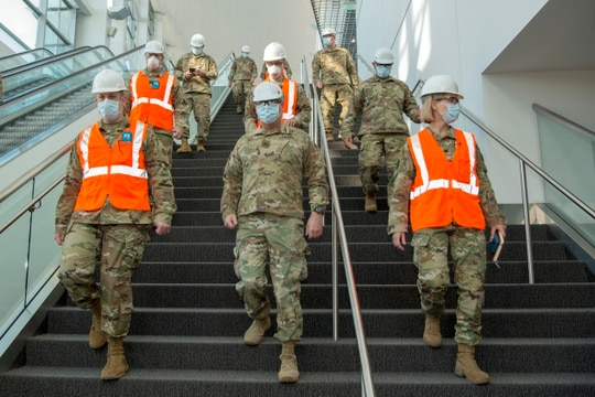 Brig. Gen. Douglas Paul, center, tours the Colorado Convention Center in Denver, April 20, 2020, where the state's Guardsmen served during the coronavirus pandemic. (Senior Master Sgt. John Rohrer/Air Force)