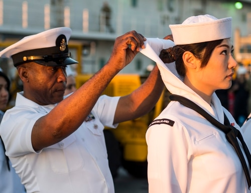 Senior Chief Aviation Support Equipment Technician Augustine Ilomuanya, assigned to the amphibious assault ship USS Makin Island (LHD 8), conducts a dress white uniform inspection. (Mass Communication Specialist 2nd Class Colby A. Mothershead/Navy)