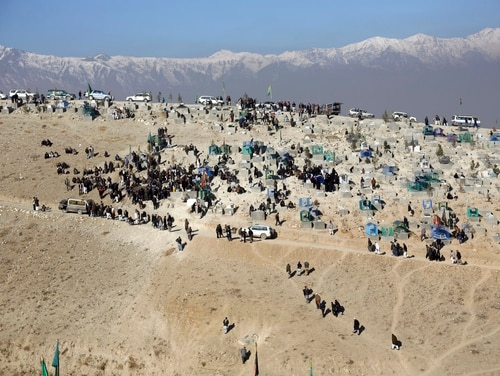 Afghan people bury victims of Thursday's suicide attack on a Shiite cultural center in Kabul, Afghanistan, Friday, Dec. 29, 2017. (Rahmat Gul/AP)