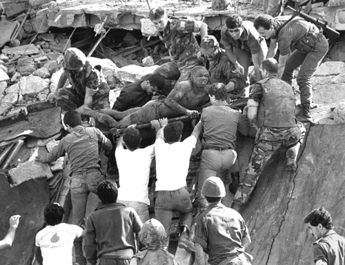 In a file photo, British soldiers give a hand in rescue operations at the site of the bomb-wrecked U.S. Marine command center near Beirut, Lebanon, airport Sunday, Oct. 23, 1983. Imad Mughniyeh, the militant accused of attacks that left hundreds of Americans and Israelis dead, has been killed, Hezbollah said Wednesday Feb. 13, 2008. He was suspected of masterminding the attack on Marine base in Lebanon that killed more than 260 Americans in 1983. (Bill Foley/AP)