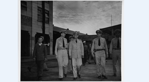 Cmdr. William C. Hagey, Rear Adm. Milton E. Miles and Lt. Elmo R. Zumwalt Jr., .on the docks at Shanghai, China, October 1945. (National Archives)