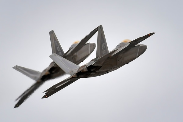 Two F-22 Raptors from Joint Base Elmendorf-Richardson, Alaska's 3rd Wing conduct approach training, Thursday, March 24, 2016. The F-22 is the U.S. Air Force's premium fifth-generation fighter asset. (U.S. Air Force photo/Justin Connaher)