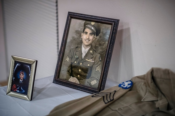 In a Sept. 23, 2017, photo, a young Joe Romero who is a Bataan Death March survivor is depicted in this photograph on display during a ceremony in which he received a Bronze Star as well as other medal as he also celebrated his 97th birthday, in Albuquerque, N.M. (Roberto E. Rosales/The Albuquerque Journal via AP)