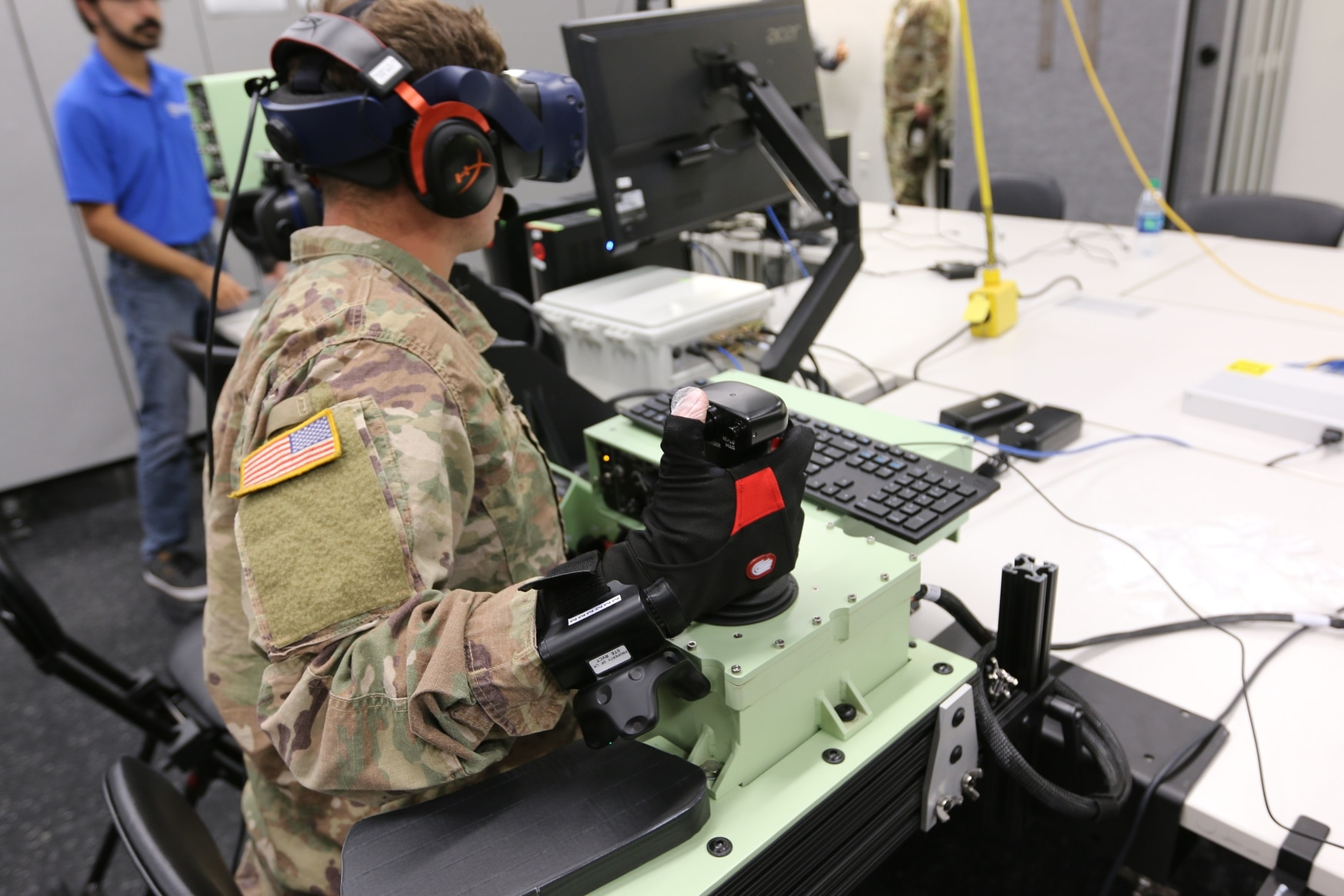 Soldiers at Fort Riley, Kansas, assess a RVCT—Ground prototype that could serve as a trainer for current and future ground vehicles in the Army inventory. The trainer will be a part of the future STE under development. (U.S. Army)