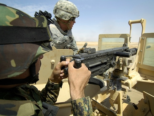 An Iraqi army officer takes aim with a .50-caliber M2 machine gun during a live-fire demonstration at Besmaya Range, adjacent to Forward Operating Base Hammer, Iraq, on Sept. 13, 2008. The demonstration was conducted by U.S. Soldiers from 2nd Brigade Combat Team, 1st Armored Division.