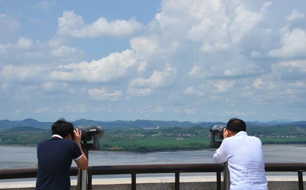 Visitors look through binoculars towards North Korea from a South Korean observation post in Paju near the Demilitarized Zone (DMZ) dividing two Koreas on August 11, 2017. (Jung Yeon-Je/AFP/Getty Images)